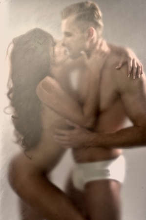 sex pose: Couple hugging behind window