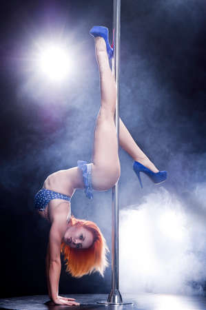 Young sexy pole dance woman. Stock Photo