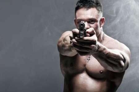 Serious Male Holding a Gun photo