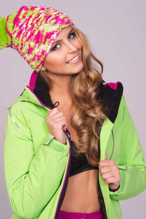 Portrait of young smiling woman in warm clothes photo