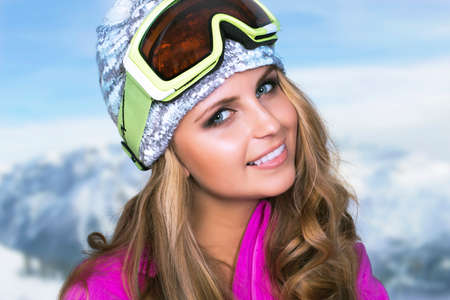 Beauty smiling woman in winter in mountains photo