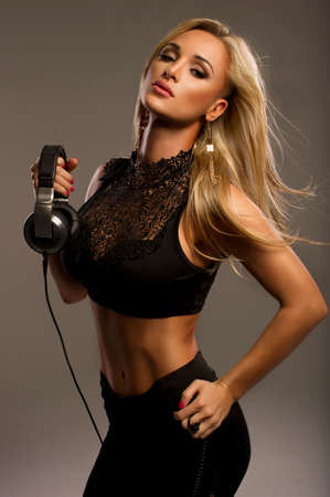 Sexy woman with headphones photo