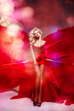 Sexy blond beauty woman in red dress photo