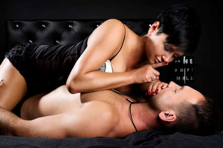 Young sexy couple in a bed Stock Photo - 24493022