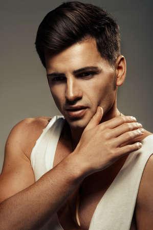 Sexy fashion portrait of a hot male model photo