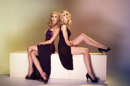 Two elegance ladies hugging photo