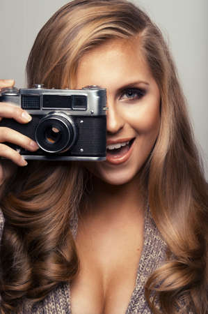 Smiling woman with camera photo