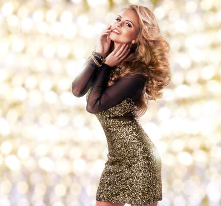 sequins: Beauty woman in gold dress