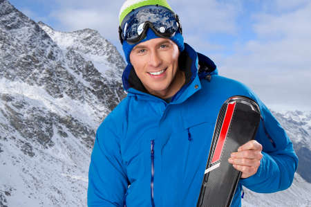Beauty smiling man in winter in mountains photo
