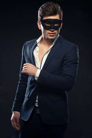 black mask: Handsome man in mask