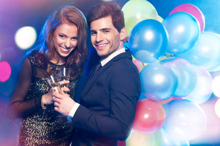Smiling couple with glasses of champagne Stock Photo - 25567338