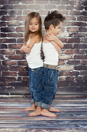 resentful: Two resentful kids in studio Stock Photo