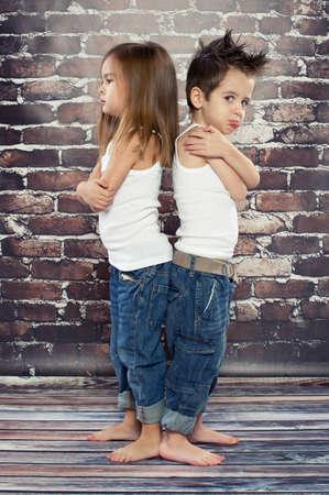resentful: Two resentful kids in studio Stock Photo