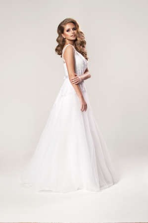 Beauty young woman in wedding dress photo