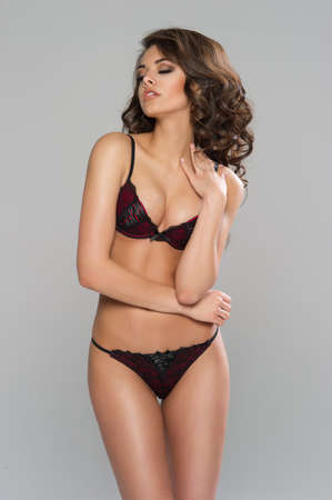 dark haired woman: Sexy dark haired woman posing in black lingerie Stock Photo