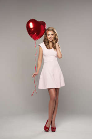 Beauty smile woman with balloon photo