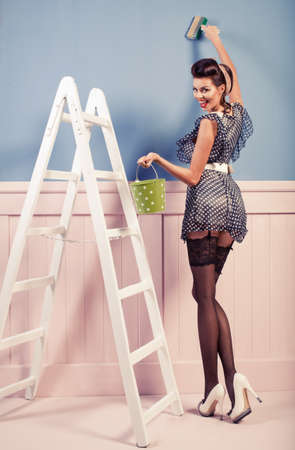 Legs and heels: Beauty pinup girl painting on the wall