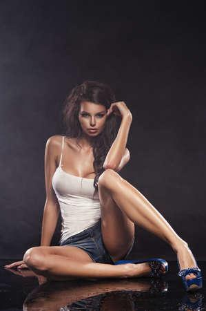 nude fashion model: Young sexy woman. Water studio photo. Stock Photo