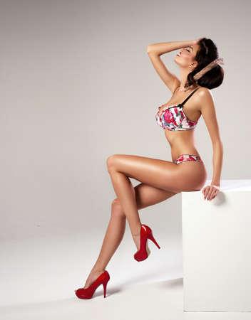 Fashion sexy woman with long legs posing photo