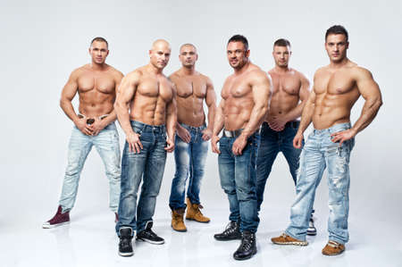 Group of six muscular young sexy wet naked handsome man posing photo