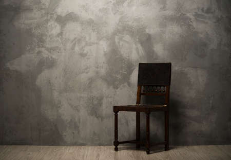dark room: Old fashioned chair on wooden floor