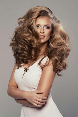 long blonde hair: Cute sexy blond woman in studio