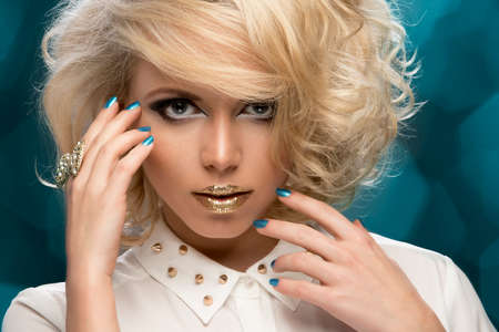 Beauty portrait woman with golden makeup and blonde hair photo