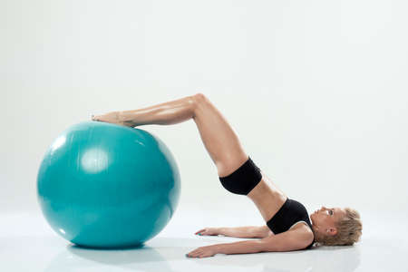 one caucasian woman exercising fitness ball workout photo