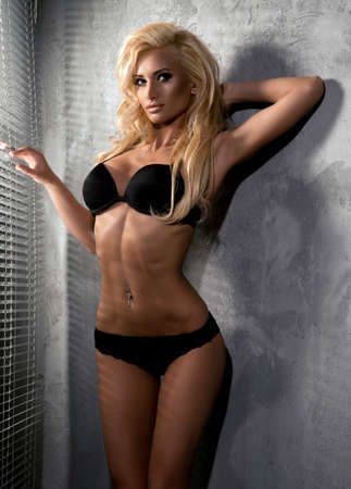 young sexy woman in black lingerie photo