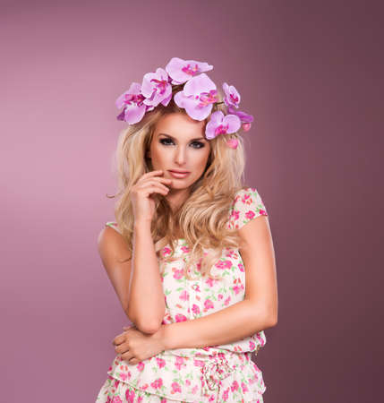 young beautiful woman portrait with wreath of flowers studio shot photo