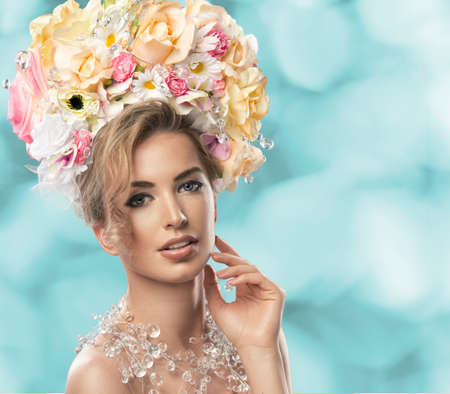 fashion model with large hairstyle and flowers in her hair. photo