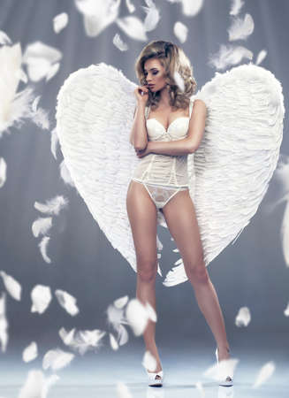 Photo of sexy blonde woman with long hair wearing angel