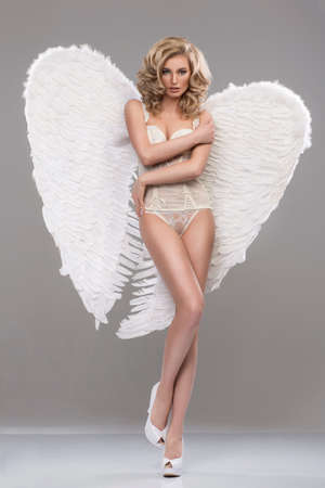 Photo of sexy blonde woman with long hair wearing angel photo