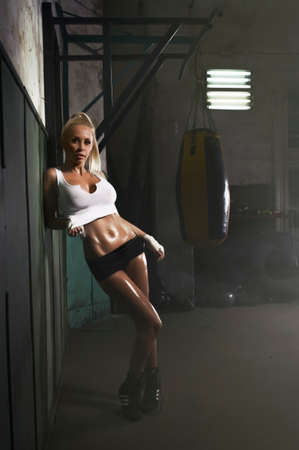 punched: Sexy blonde woman posing in hall