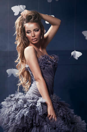 fantasy woman: Beauty blonde woman on the fog with butterflies Stock Photo