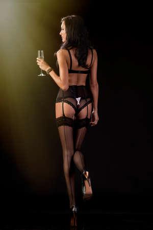 Cute brunette celebrates in evening attire
