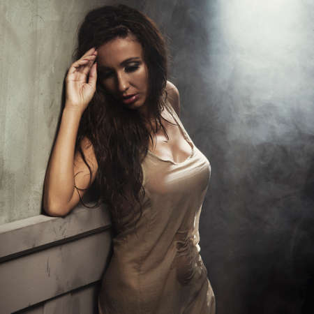 human sexual activity: Sexy beautiful woman dancing, looking at camera.
