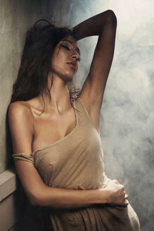 Sexy beautiful woman dancing, looking at camera.