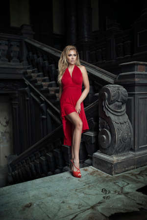 supermodel: Attractive young woman supermodel standing on stairs