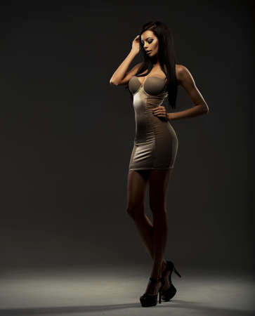 Fashionable young brunette sensual woman photo