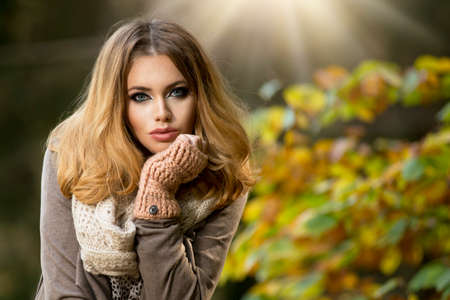 Beautiful elegant woman  in a park in autumn Stock Photo