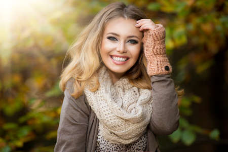 white glove: Beautiful elegant woman  in a park in autumn Stock Photo