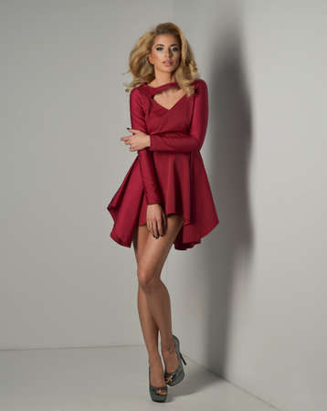 Sexy young beauty blonde woman in red dress photo