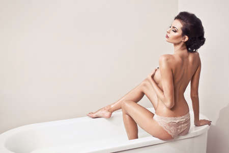 naked woman back: Beautiful nude sexy woman in the bath Stock Photo