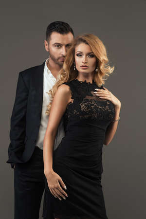 sexy dress: portrait of a young fashion couple looking into the camera Stock Photo