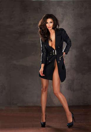 beautiful nude woman: Fashion shot of a woman in black coat