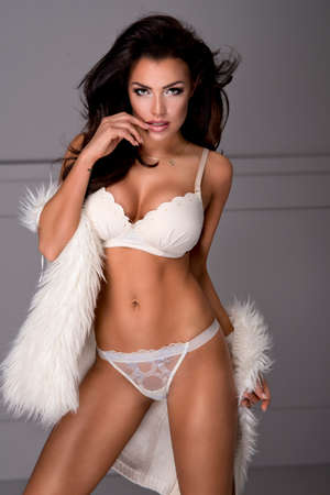 white fur: Sexy brunette woman wear lingerie and fur Stock Photo
