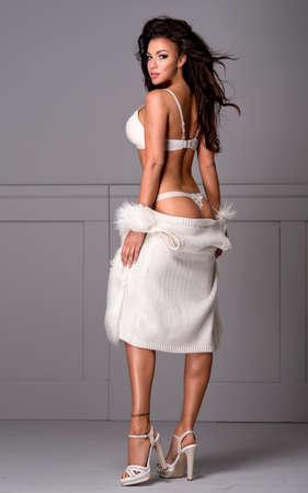 woman fur: Sexy brunette woman wear lingerie and fur Stock Photo