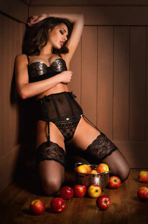 girl apple: Sexy beautiful girl sitting on a floor with apple Stock Photo