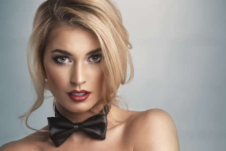 naked women: Black bowtie worn by a model with red lips. Naked model